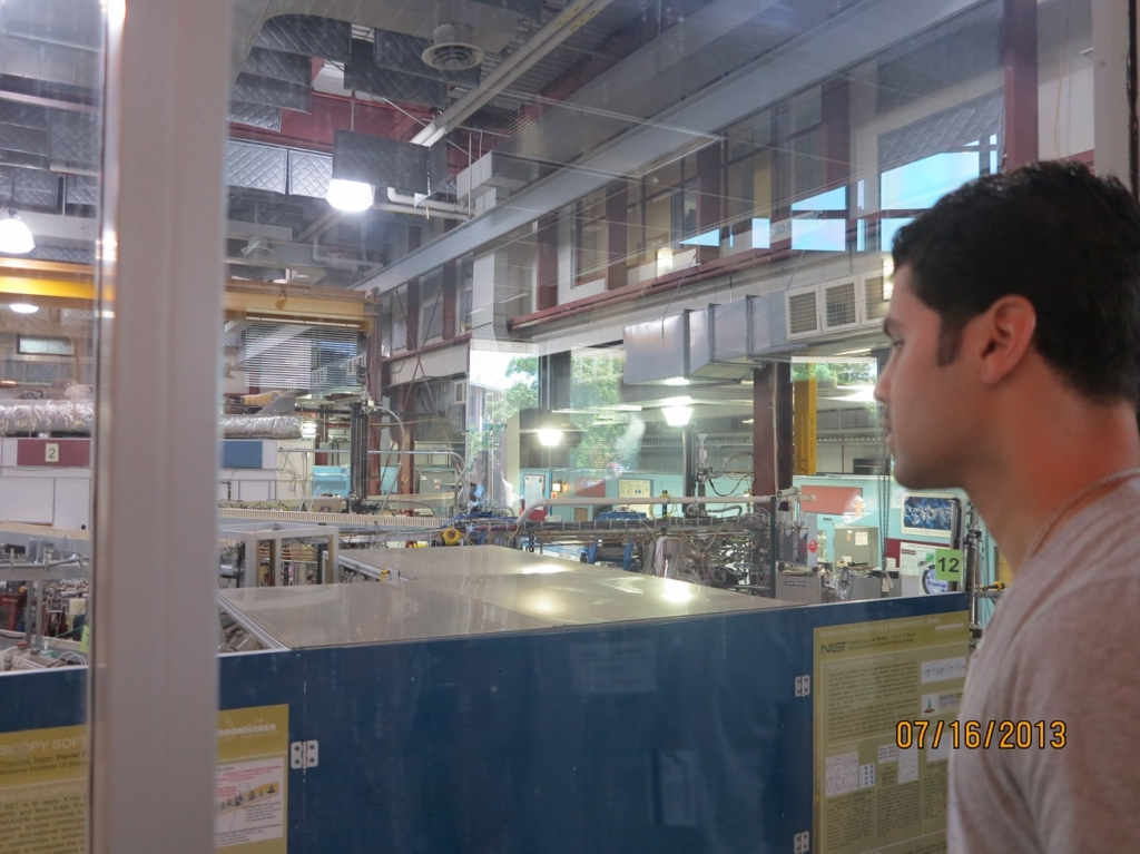 Student Carlos Perez focuses on the wiring systems at the BNL